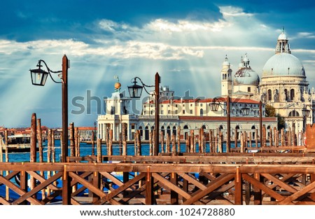 Grand Canal in Venice Italy sunset view Cathedral of Santa Maria della Salute picturesque skyline landscape.