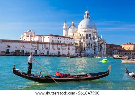 Grand Canal with gondola against Basilica Santa Maria della Salute in Venice, Italy #561847900