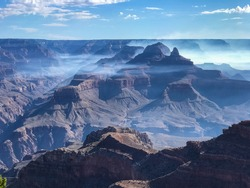 Grand Canyon and Bright Angel Canyon with fog near Zoroaster Temple.  South Kaibab Trail and Skeleton Point visible below.