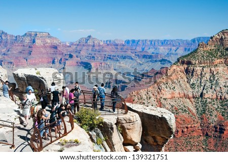 GRAND CANYON, ARIZONA - SEPTEMBER 30, : Tourist looking at south rim of Grand Canyon on September 30, 2011 in Arizona, USA. Grand Canyon is 277 miles (446 km) long, up to 18 miles (29 km) wide.