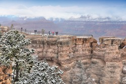 Grand Canyon foggy weather landscape in Arizona, United States. Mather point view with snow.