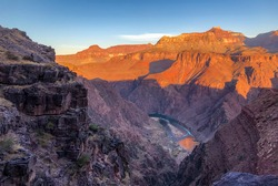 Grand Canyon National Park, Arizona, USA - OCTOBER 26, 2020: Sunrise on Grand Canyon National Park and the Colorado river with a  beautiful red color on the horizon.
