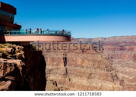 Grand Canyon National Park, West Rim, Arizona, USA. Layered bands of red rock revealing millions of years of geological history. Skywalk is a horseshoe-shaped cantilever bridge with a glass walkway.