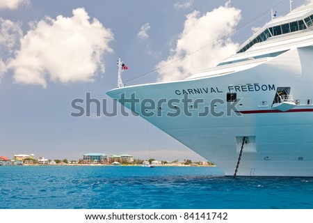 GRAND CAYMAN, CAYMAN ISLANDS  - JULY 13:  A cruise ship anchors near Grand Cayman and is required to tender visitors to the port on July 13, 2011.  Grand Cayman is the capital of the Cayman Islands.