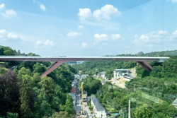 Grand Duchess Charlotte Bridge or red bridge connecting Kirchberg plateau and City centre shot from Pfaffenthal lift