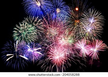 Grand finale of fireworks over dark background #204058288