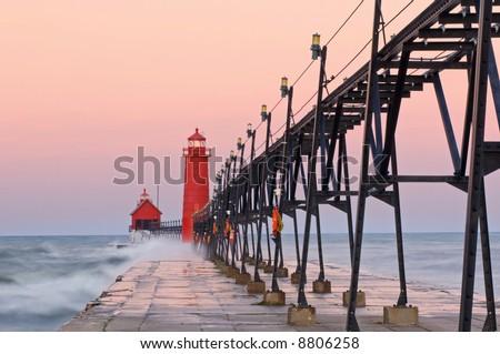 Grand Haven, Michigan Lighthouse at dawn with splashing waves, Lake Michigan, USA
