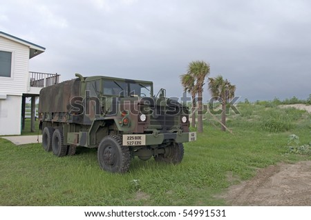 GRAND ISLE, LA - JUNE 5: National Guard vehicle near beach on June 5, 2010 in Grand Isle, LA. The BP oil spill that began April 20th, 2010, has resulted in oil washing up on the shores of Louisiana.