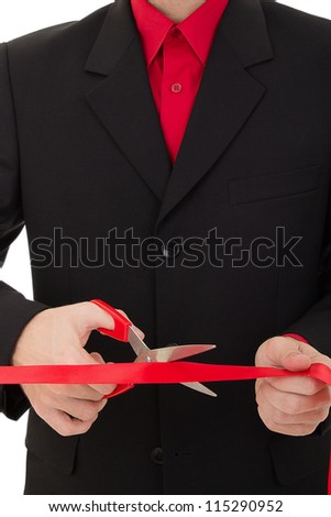 grand opening ceremony. man cutting the red ribbon with scissors