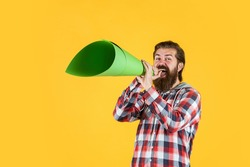 grand opening. marketing and advertising. mature guy in checkered shirt with paper megaphone. stylish male use speaker. speak loud. bearded man with important announcement. attention