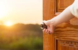 Grand opening women hand open door knob or opening the door, grand opening, Close up hand open door.