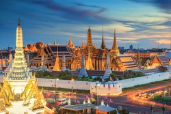 Grand palace and Wat phra keaw at sunset Bangkok, Thailand. Beautiful Landmark of Asia.  Temple of the Emerald Buddha. landscape of the capital city. view of thailand