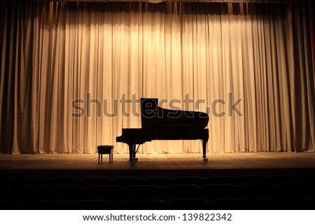 Grand Piano At Concert Stage With Brown Curtain