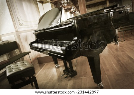 Grand-piano with a chair in the hall