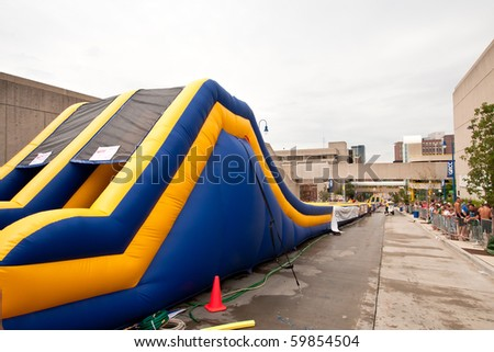 GRAND RAPIDS, MI- AUG 21: Lyon Street is transformed into a waterpark with a 500-foot water slide, said to be the world's longest, installed by Rob Bliss Events on Aug 21, 2010 in Grand Rapids, MI.