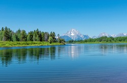 Grand Teton peaks by Snake River in summer by Oxbow Bend, Grand Teton national park, Wyoming, USA.