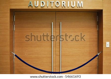Grand wooden auditorium entrance. For various business and lifestyle concepts.