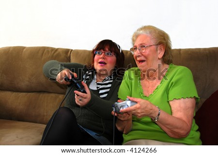 Granddaughter and Grandmother Playing Video Games