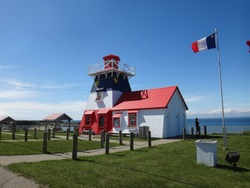 Grande-Anse Lighthouse with Acadian Flag in New Brunswick, Canada