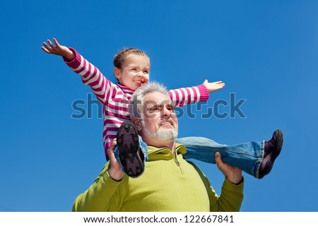 Grandfather and grandchild happy together