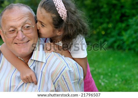 Grandfather and granddaughter having fun outdoors