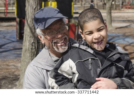 Grandfather and grandson at the park