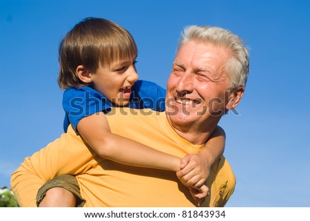 grandfather and grandson playing at the nature