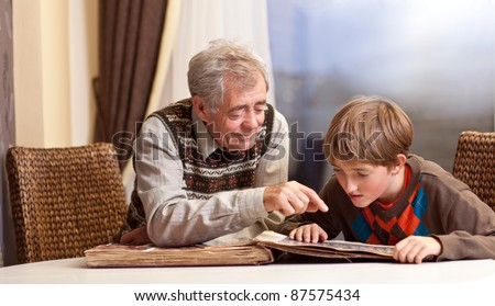 Grandfather and grandson watch  family album