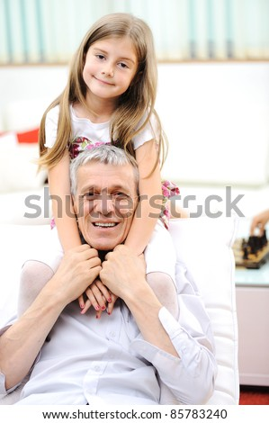 Grandfather and his little girl indoor