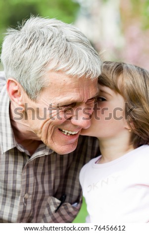 grandfather and his little granddaughter together