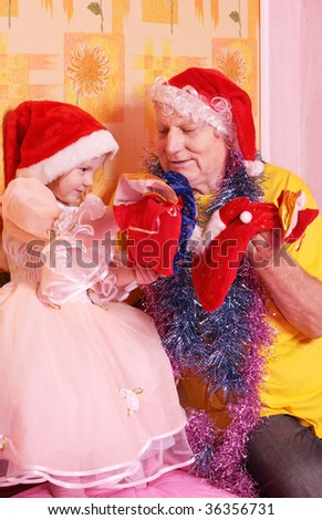 grandfather and little girl in red christmas hat