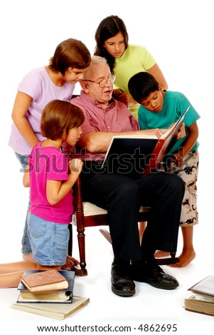 Grandfather sharing photo albums with four of his grandchildren.  Isolated on white.