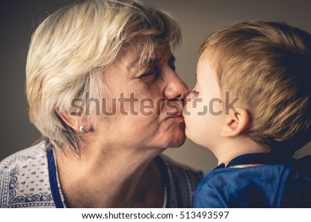 Grandma and Grandchild kissing