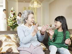 grandma and granddaughter playing at home