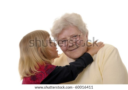 grandma and granddaughter whispering