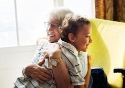 Grandma and grandson hugging after social distancing