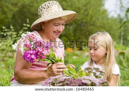 Grandma and her grandchild have a rest in the park