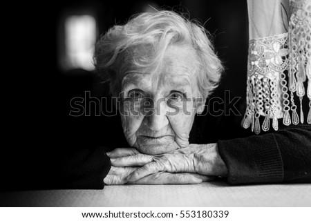 Grandma. Closeup black and white portrait of an elderly woman.