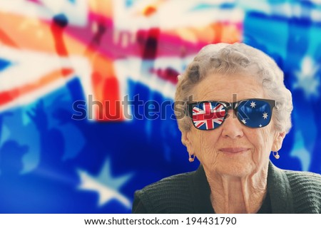 Grandma fan with national color glasses, in the background are silhouette of fans and national flag #194431790