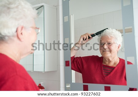 grandma is combing the hair