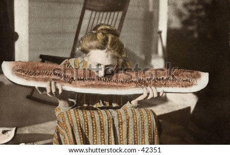 Grandma Pigs Out - a circa 1900 hand-tinted black & white photograph of grandma, on the front porch, pigging-out on a HUGE slice of watermelon.