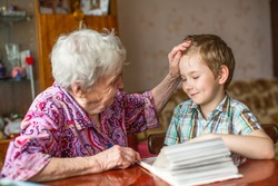 Grandma shows book for little grandson.