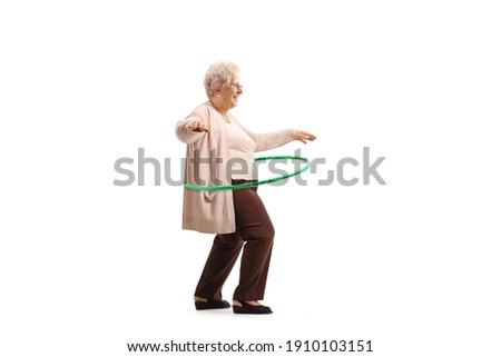 Grandma spinning hula hoop isolated on white background Stock photo ©