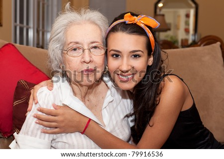 Grandmother and granddaughter in a home setting.