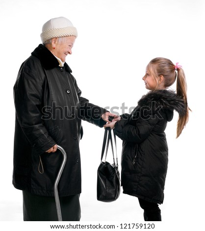 Grandmother and granddaughter in winter outwear on white background