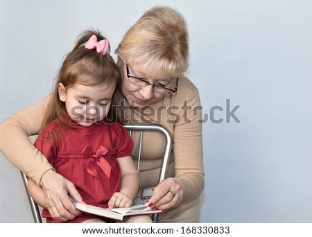 Grandmother and granddaughter read the book