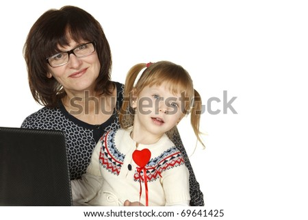 Grandmother and granddaughter with laptop isolated on white background
