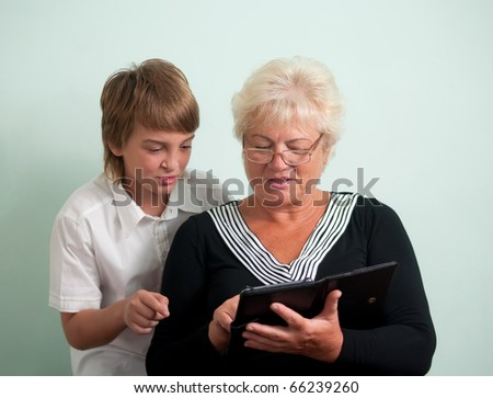 Grandmother and her grandson, read e-books.
