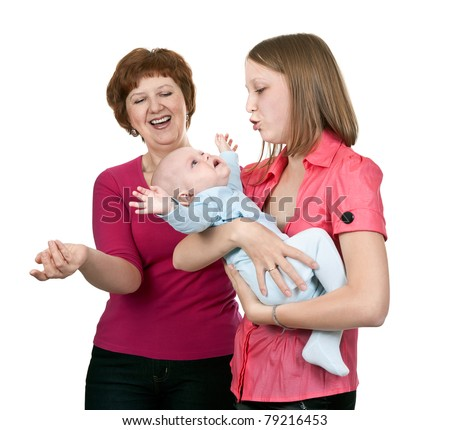 grandmother and mother soothe crying baby on a white background