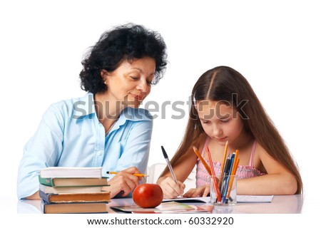 Grandmother helping her granddaughter with her home-work, holding hand under chin.Grandmother helping her granddaughter with her home-work, holding hand under chin.